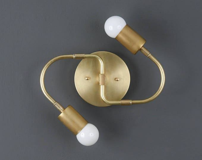 Lakeland Wall Sconce [Raw Brass - Mid Century - Modern - Industrial - 2 Light - 2 Bulb - Curved Arm - Bathroom - Vanity - UL Listed]