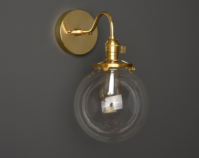 Altha Wall Sconce [Raw Brass - Mid Century - Modern - Industrial - Single Light - Clear 8 Inch Glass Globe - Vanity - Art Light - UL Listed]