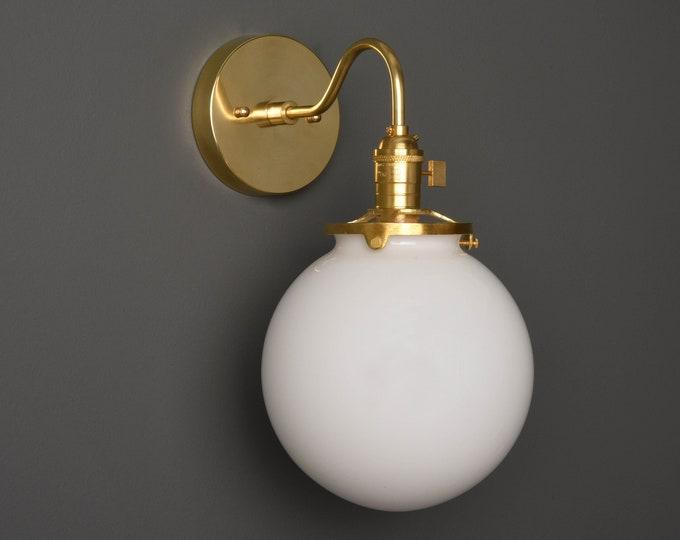 Wall Sconce - Raw Brass - Mid Century - Modern - Industrial - Clear 8 Inch Glass Globe - Bathroom Vanity - Art Light - UL Listed [ALTHA]