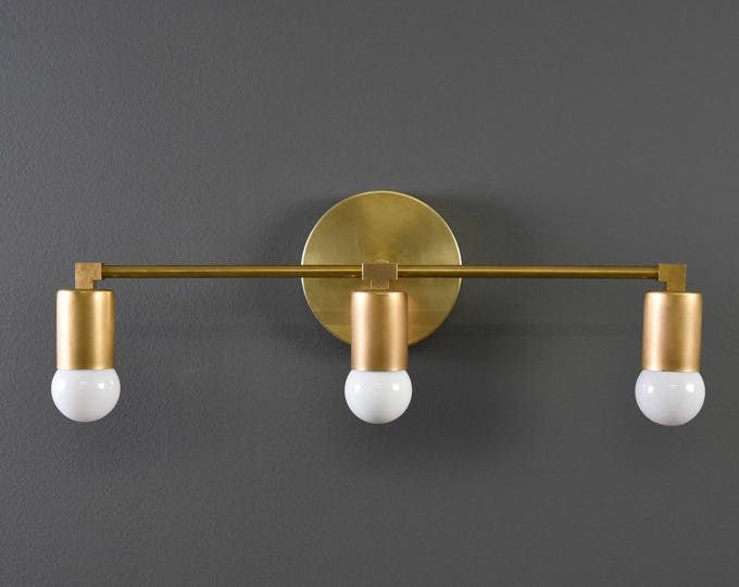 Wall Sconce Vanity Raw Brass Gold 3 Bulb Cylindrical Covers Round Base Modern Downward Abstract Mid Century Art Light Bathroom UL Listed