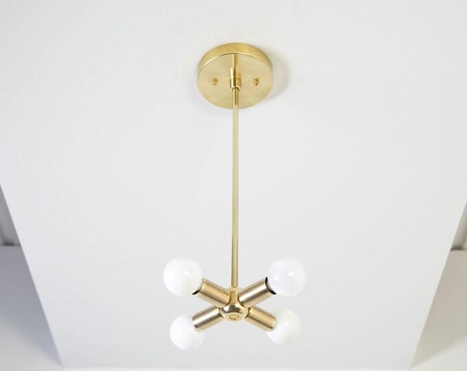 Raw Brass Pendant with 4 Candelabra Bulb Vanity Modern Mid Century Industrial