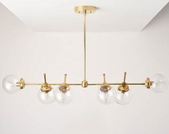 Austin Chandelier [Raw Brass - Mid Century - Industrial - Modern - Candelabra - 6 Light - 5 inch - Clear Globe - Large - UL Listed]