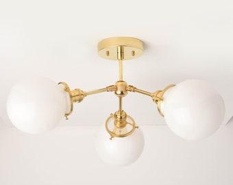 Vancouver Chandelier [Raw Brass - Mid Century - Industrial - Modern - Sputnik - Pinwheel - 3 Arm - White Globe - Edison]