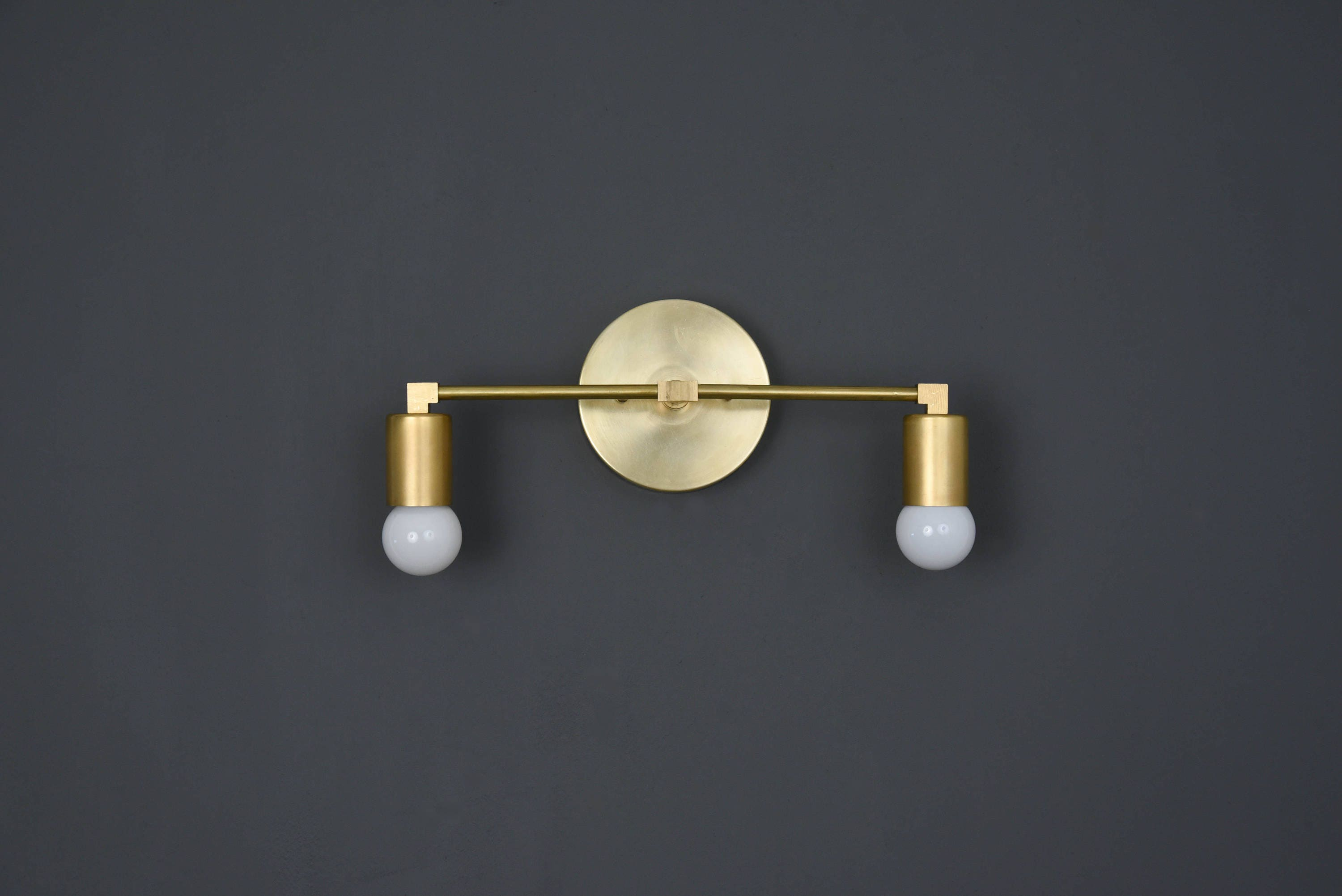 aged glass item finish cfm inch sconce capitol valley agb in wall shown hudson brass bathroom magnifying image wide lighting gordon