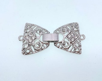 1 strand silver plated metal with rhinestone watch buckle or fold up clasp, easy on and off, 1 x 1 1/2 inch.(WB44S)