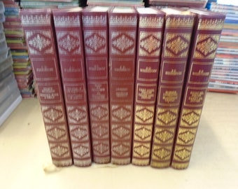 Set of 7 P.G. Wodehouse Vinyl covered books by Heron Books.