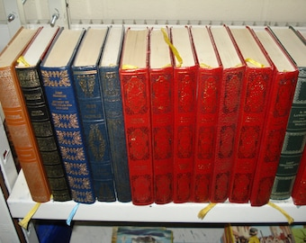 Set of 30 Vinyl covered books by Heron Books.  Mixed colours & authors