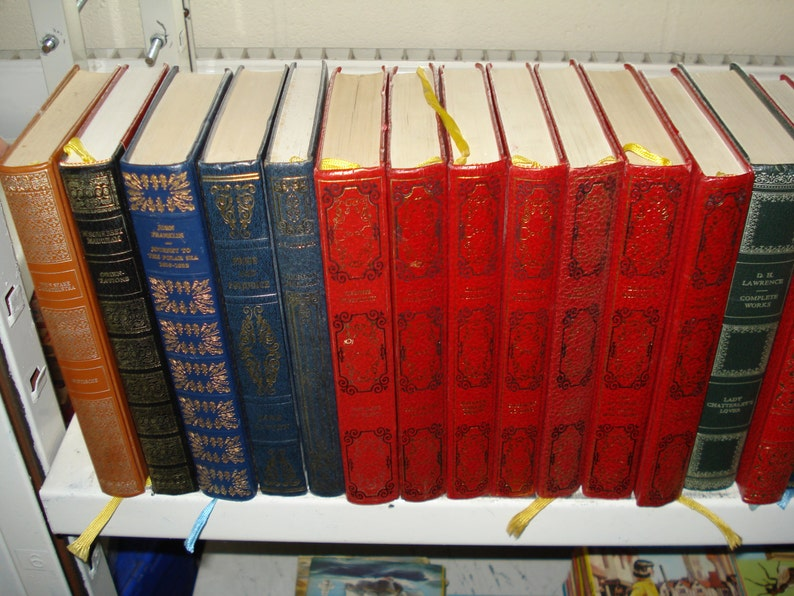 Set of 30 Vinyl covered books by Heron Books.  Mixed colours & image 0