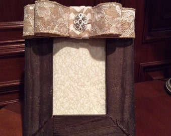 Rustic barn board frame with bow
