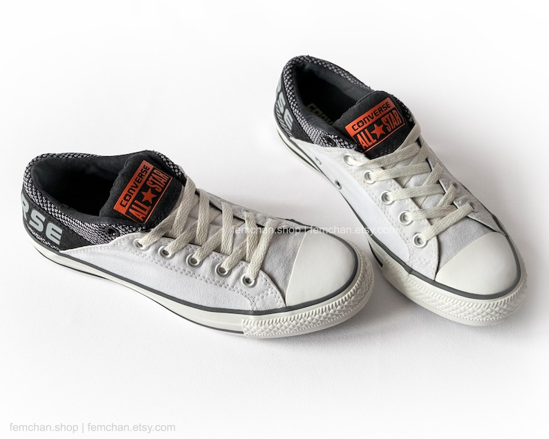 f1cb3f748bbc Converse All Stars in black and white Converse CT Band low