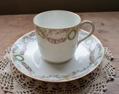 T V LIMOGES France - Demitasse Cup and Saucer - Pattern 5511 Ink Stamped is Ca. 1907-1919 Gold Trim w Wreaths and Pink Draped Flowers.