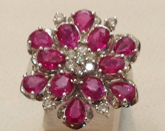 18 K white gold ruby and cluster diamond ring