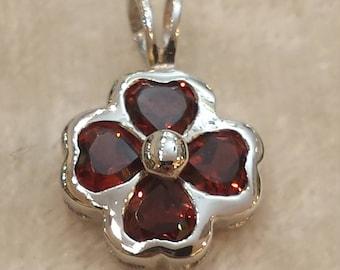 14 K white gold garnet pendant