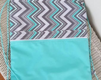 Teal and grey chevron rucksack backpack messenger bag with front pocket lined over the shoulder bag purse