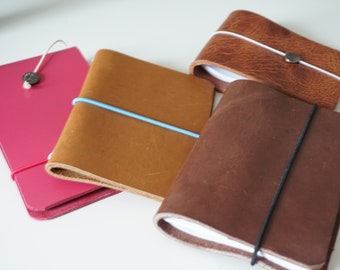 Leather notebooks handmade different versions