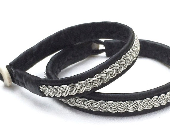 Traditional Scandinavian Sami reindeer leather bracelets, with a pewter braid and antler button.
