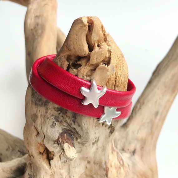 Wrap around reindeer leather bracelet with a magnetic clasp and starfish silver slider.