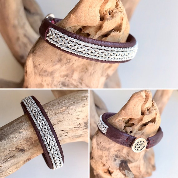 Sami traditional burgundy reindeer leather bracelet with borders and a tree of life pewter button.