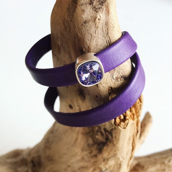 Purple reindeer leather bracelets with magnetic clasp and a square purple Swarovski slider.