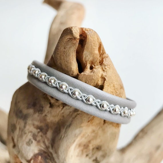 Sami light grey reindeer leather, sterling silver beads bracelet with a pewter button.