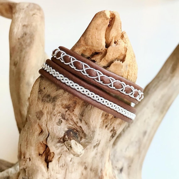 Traditional nougat Sami reindeer leather and pewter bracelets.