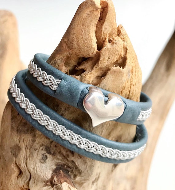 Traditional double Sami reindeer leather bracelets, with a braid of flat pewter threads and a silver heart.