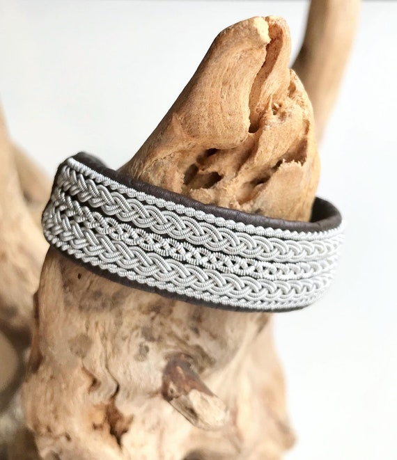 Traditional Scandinavian leather cuffs, with pewter threads braids and pewter button.