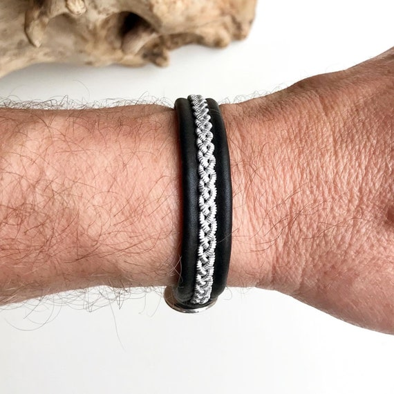 Traditional black Sami reindeer leather bracelet with flat pewter and a Celtic knot pewter button.