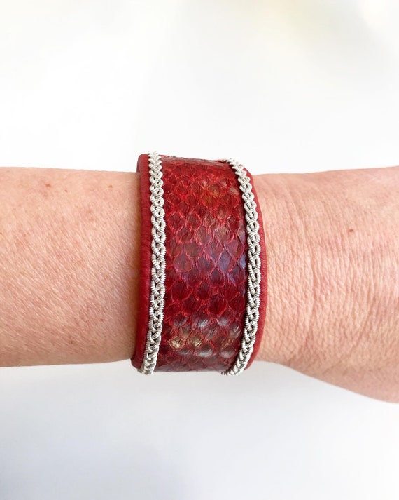 Wide red salmon and reindeer leather cuff bracelet, with a magnetic clasp and pewter braids.