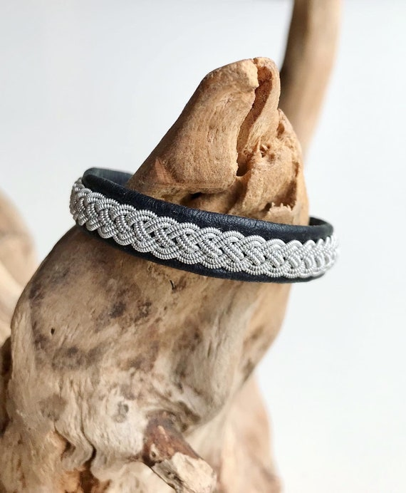 Traditional Sami black reindeer leather bracelet with pewter braid  and pewter button.