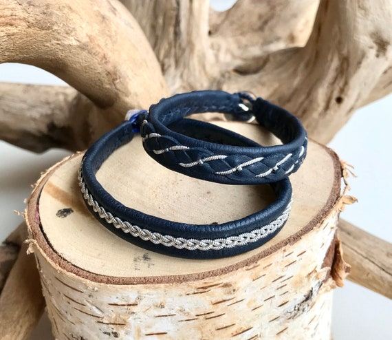 Sami traditional navy reindeer leather and pewter bracelets.