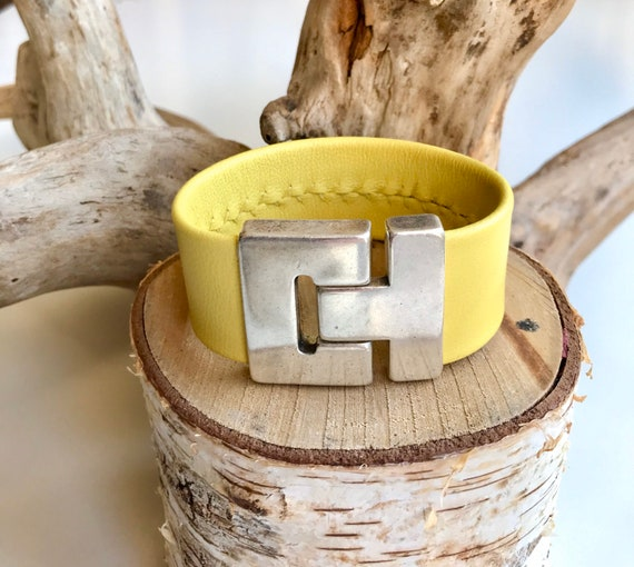 Lemon yellow reindeer leather cuff with a magnetic clasp.
