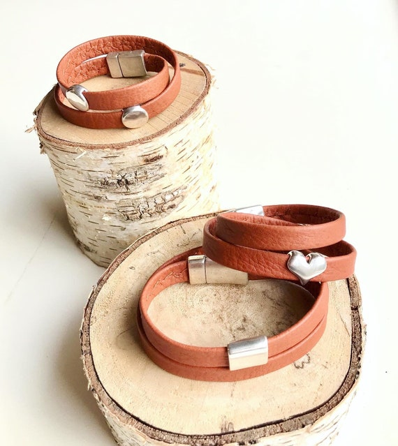 Tan wrap around reindeer leather bracelets with a magnetic clasps.
