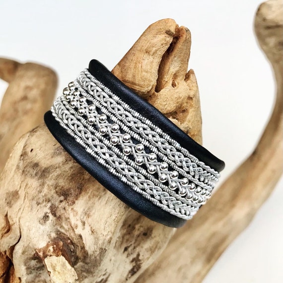 Viking leather cuffs, with pewter threads and sterling silver beads.