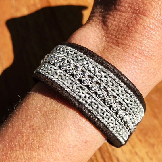 Traditional Scandinavian leather cuffs, with pewter threads braids and sterling silver beads.