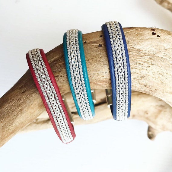 Lapland Sami reindeer leather bracelets with a braid of flat pewter threads and borders.