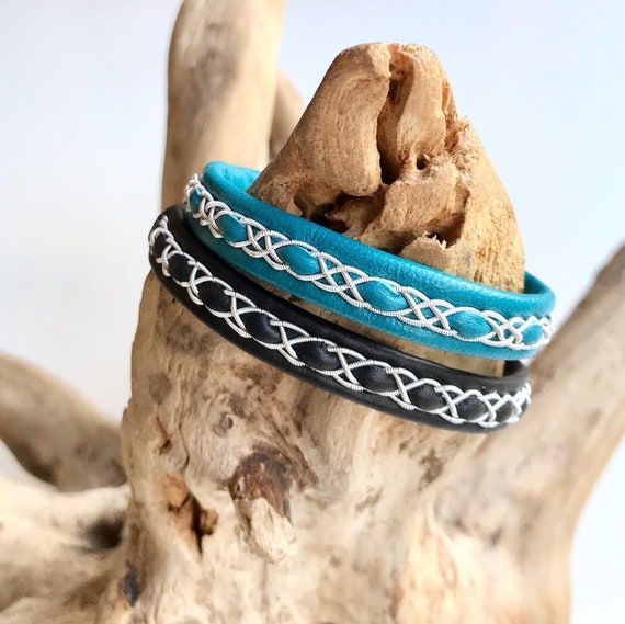 Traditional Sami reindeer leather bracelets in black or teal, with a pewter braids.