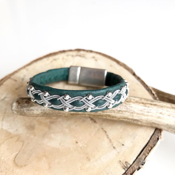 Forest green reindeer leather bracelet with traditional pewter braiding and sterling silver beads.
