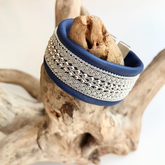 Traditional Scandinavian blue leather cuffs, with pewter threads braids and sterling silver beads.