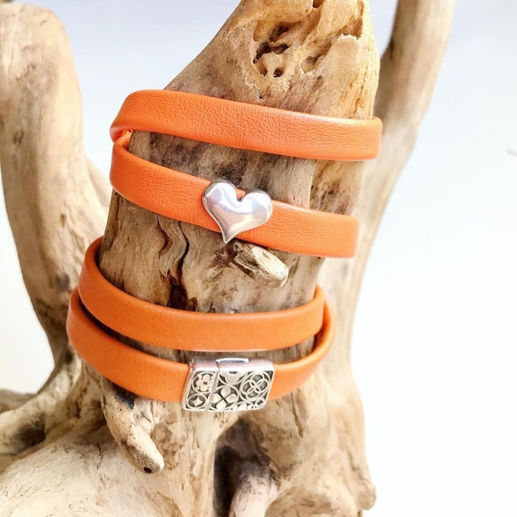 Orange wrap around reindeer leather bracelet with a magnetic clasp and silver heart OR with a detailed magnetic clasp.