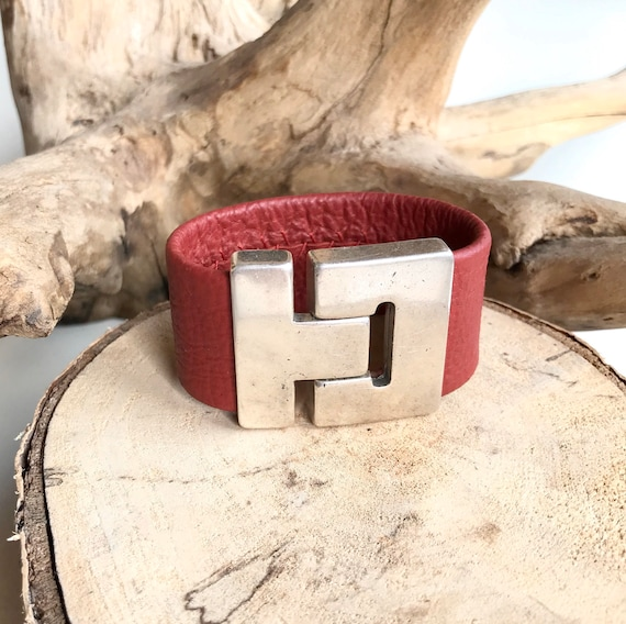 Red reindeer leather cuff with a magnetic clasp.