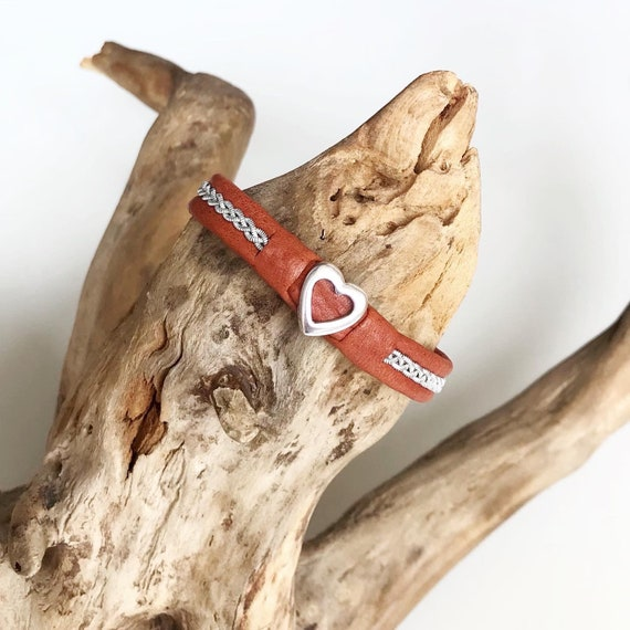 Sami tan reindeer leather bracelets with a silver heart.