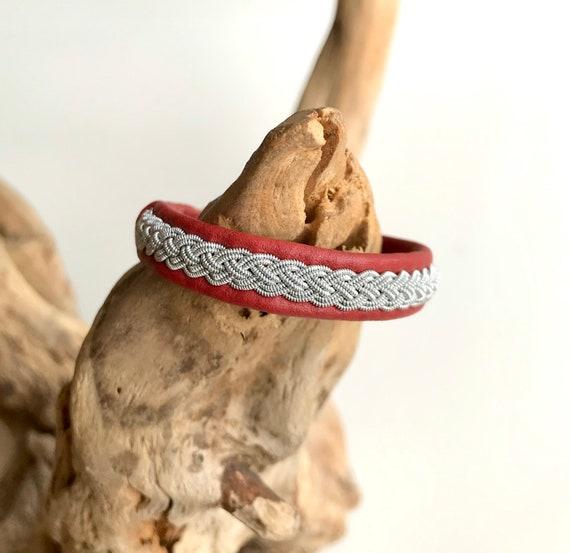 Swedish Sami dark red reindeer leather bracelet with traditional pewter braiding.