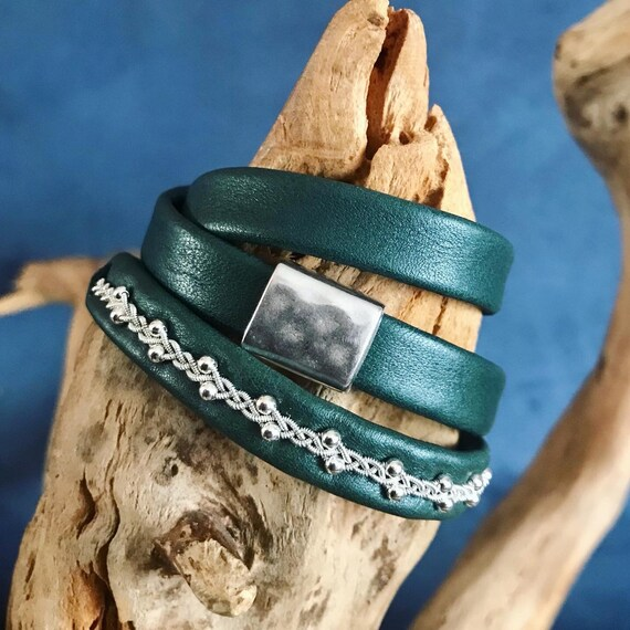 Forest green shimmer reindeer leather accessories.