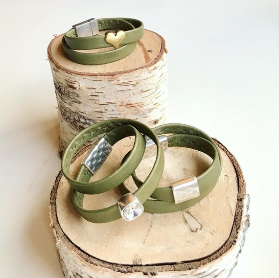 Wrap around light olive shimmery reindeer leather bracelets with a magnetic clasps.