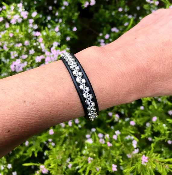 Sami reindeer leather bracelets with flat rectangular sterling silver beads.