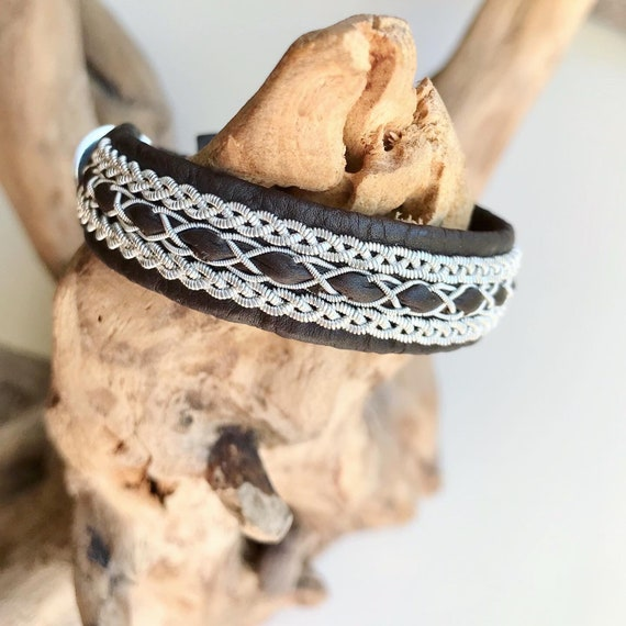 Traditional brown reindeer leather Sami bracelet, with pewter threads braids and pewter button.