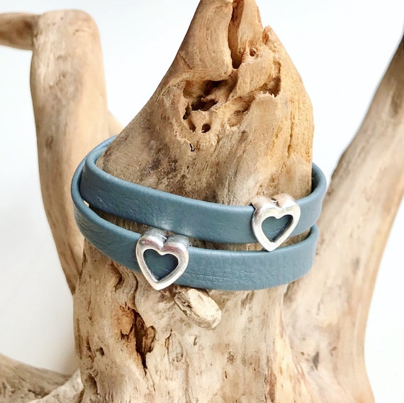 Wrap around reindeer leather bracelet with a magnetic clasp and two heart silver sliders.