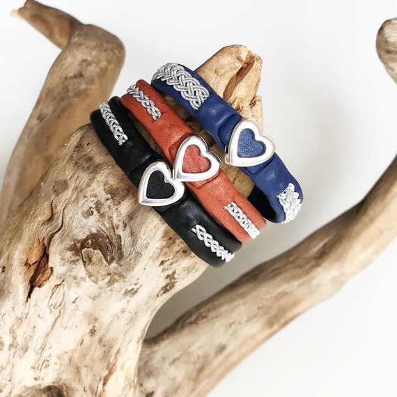 Sami reindeer leather bracelets with a silver heart.