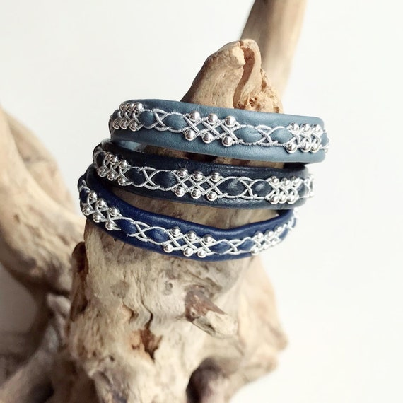 Pewter braided leather bracelet with sterling silver beads.